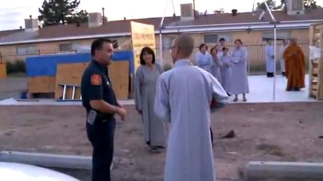 An Albuquerque Fire Department inspector speaks with members of the Hoi Phuoc Buddhist Temple about setting off illegal fireworks.