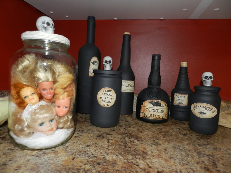 Easy halloween decor. Painted black jars and labels