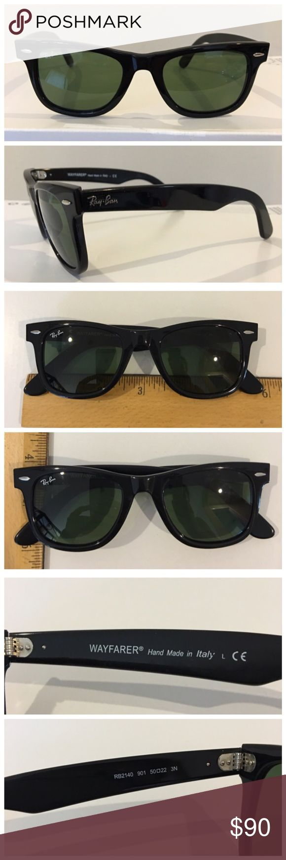 Authentic RAY BAN Wayfarer sunglasses, black Authentic RAY BAN Wayfarer sunglasses. Black frames in excellent condition, with no perceptible scratches. Lens inscribed with signature Ray-Ban word and initials. See photo for measurements. Hand made in Italy. Model RB2140. Does not come with a case. In excellent preowned condition. Please ask any questions you may have before purchasing. Trades.  Low ball offers. Ray-Ban Accessories Sunglasses