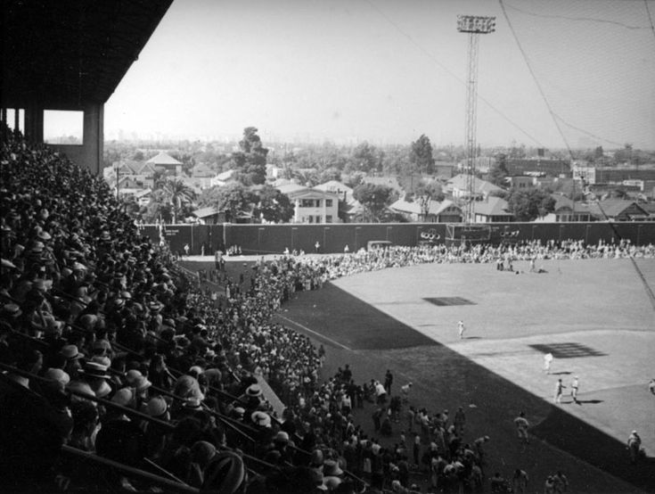 "Early 1930s.  The ""first"" Wrigley Field in Los Angeles, CA. The double-decked grandstand extended from the left field foul pole to home plate, and around to the right field foul pole. Bleachers and a scoreboard were located in right field. There was no seating in left field. The left field concrete wall was later covered in ivy as was its big ""brother"" Wrigley Field in Chicago."