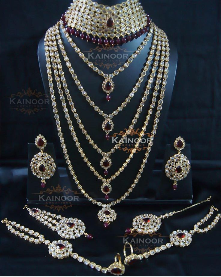"""''Jodha'' Bridal set with champagne and maroon stones including choker, Rani haar, earrings,tikka,hand jewellery,Jhumar,nose ring. This set can be…"""