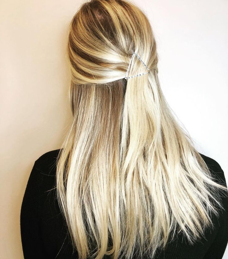 Formal doesn't have to mean fussy. This pretty half-up style from Sugar Salon Wichita is simple, but stylish.