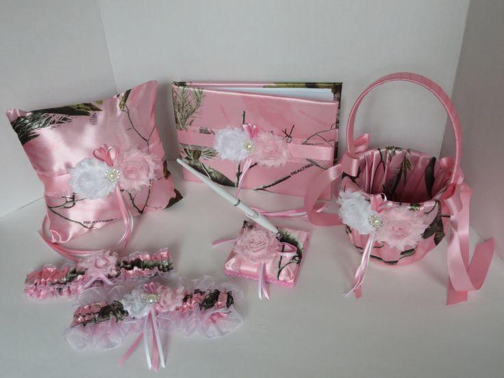Camo Wedding Set, Wedding Flower Girl Basket, Wedding Pillow, Wedding Guest Book, Pen and Wedding Garter, Realtree AP Pink Camo Wedding Set by TheMomentWeddingBout on Etsy https://www.etsy.com/listing/190051665/camo-wedding-set-wedding-flower-girl