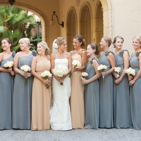 The eight bridesmaids wore gray one-shoulder floor-length gowns, while the two maids of honor wore the same dress in a gold hue.  from the album: An Elegant Outdoor Wedding in Sarasota, FL