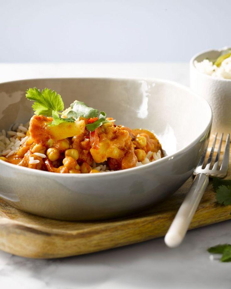 Een vegetarische Indische curry met bloemkool, met tal van kruiden en groenten. Lekker met rijst.
