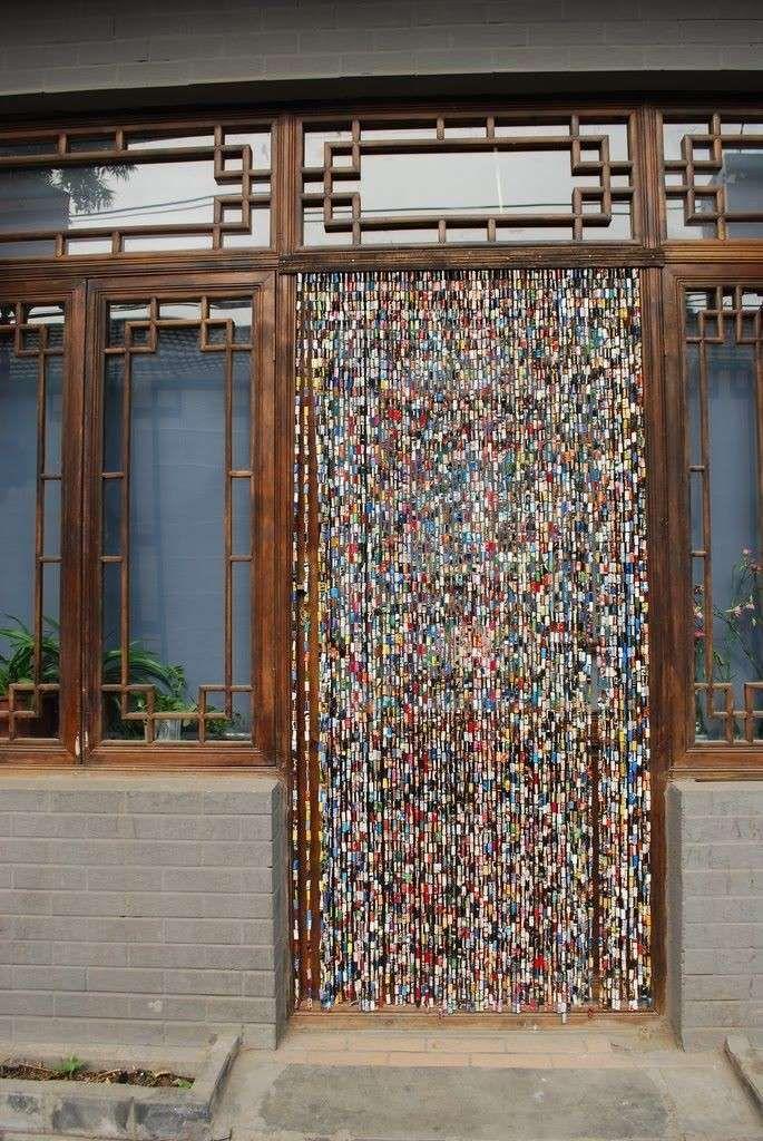 Idee per arredare casa riciclando - Tende con pagine di riviste