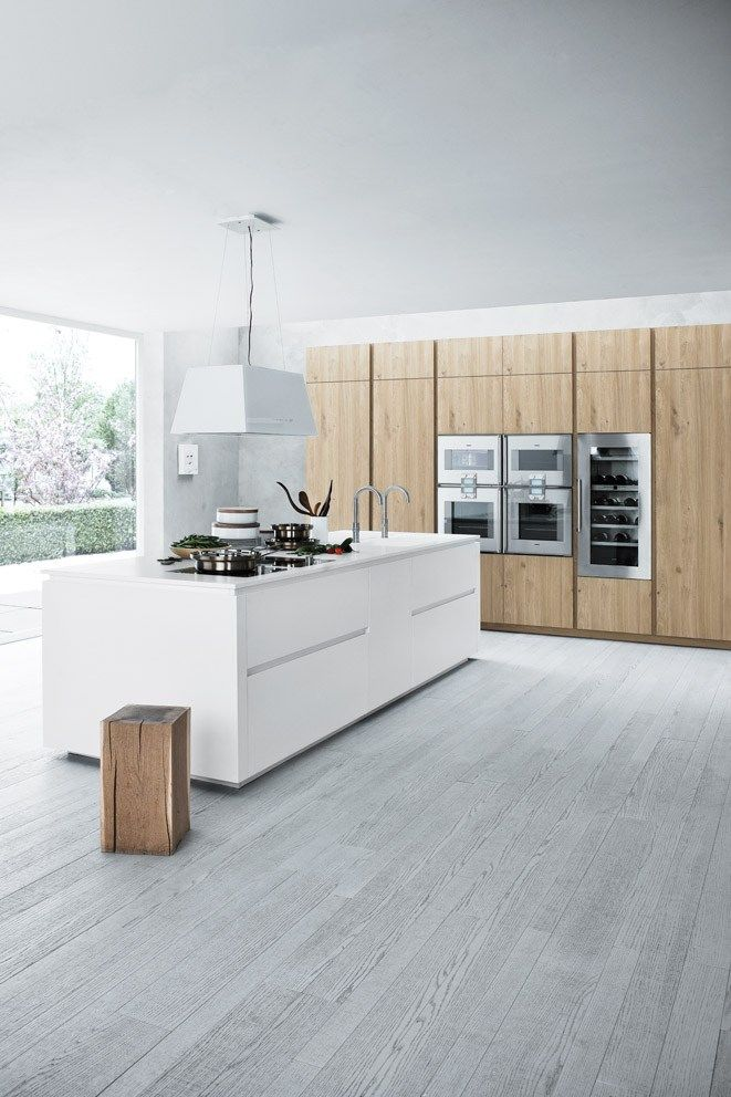 amazing space - if you have the room and space, you can have this! all pale and smooth and sexy, the combination of materials makes this a peaceful and calming kitchen.