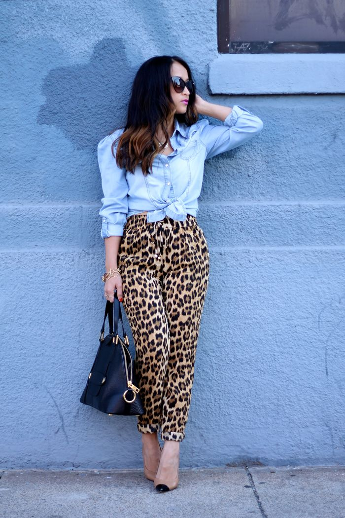 Leopard print pants, Light chambray tie front buttondown, Nude&Black captoe heels | Black&Gold handbag, Gold jewelry