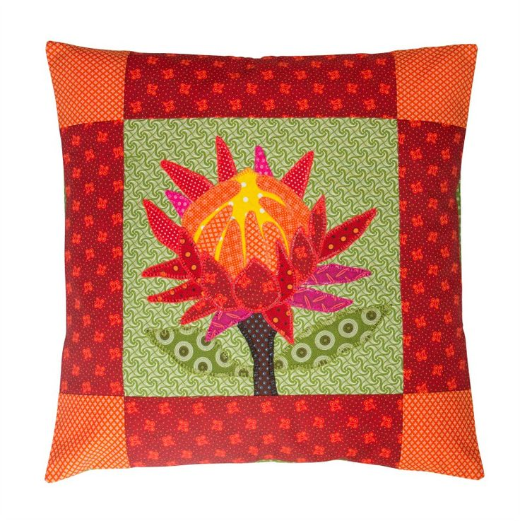 This gorgeous handmade fynbos-inspired cushion cover, made exclusively for the Gifts from Franschhoek homeware range, will brighten up any space. It is made with colourful traditional South African Shweshwe fabric. A unique handmade Protea flower has been appliqued on each design. Size: 50cm x 50cm. Handmade in South Africa. Inner excluded. 100% cotton, wash in cold water.