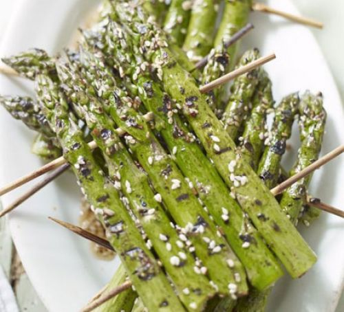 Griddling or barbecuing asparagus individually can be fiddly, but it's much easier cooking them like this – plus it looks impressive