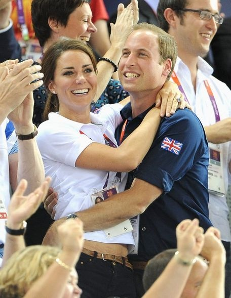 Catherine, Duchess of Cambridge and Prince William, Duke of Cambridge embrace after Philip Hindes, Jason Kenny and Sir Chris Hoy of Great Britain win the gold