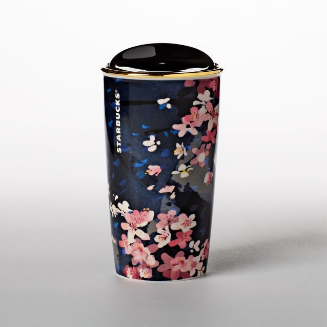 A double-walled ceramic travel mug featuring art inspired by an icon of spring. Part of the Cherry Blossom Drinkware Collection.