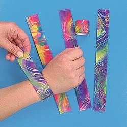 Slap bracelets!  These were eventually outlawed at school, can't remember why, but they are making a comeback I have started seeing them in stores again!