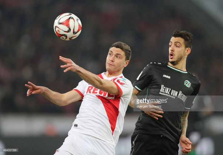 Jonas Hector of Cologne (L) and Joselu Mato of Hannover fight for the ball during the Bundesliga match between 1. FC Koeln and Hannover 96 at RheinEnergieStadion on February 21, 2015 in Cologne, Germany.