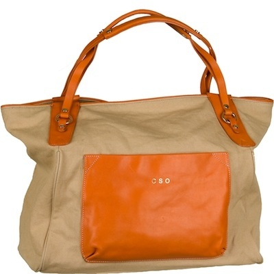 Sturdy, chic carry-on or weekender...or everyday bag if you need to schlep a ton of stuff around! Rugged tan canvas with leather straps that go over your shoulder, plus a roomy leather pocket with a hidden magnetic closure, an interior zip pocket, and solid brass fittings and feet. And for only ten bucks more, you can have it monogrammed in gold with up to three initials! Available with mango (as shown) or black leather straps and pocket. Any way you go, this tote gets you there in style…