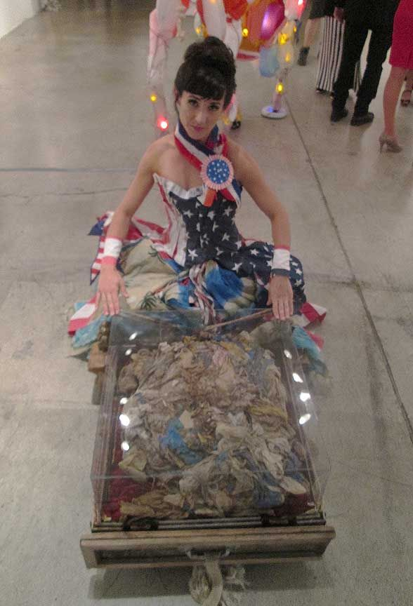 """Sophia with my piece """"Ruminations"""" which contains the contents of a camels' stomach from Dubai (all plastic bags)"""