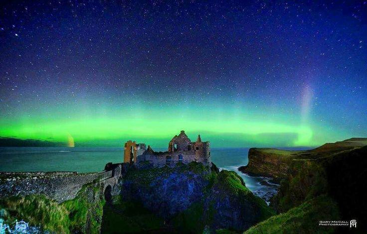 Image result for The northern lights taken at Dunluce Castle,