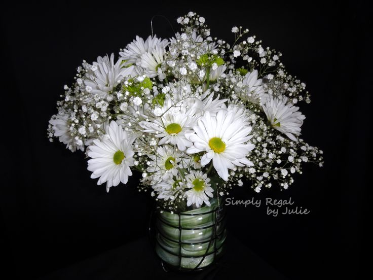 Flowers in a jar. An alternative to the Mason Jar. White Daisies and Babies Breath make this a casual arrangement for a garden centerpiece or an aisle shepherd hook - Simply Regal by Julie