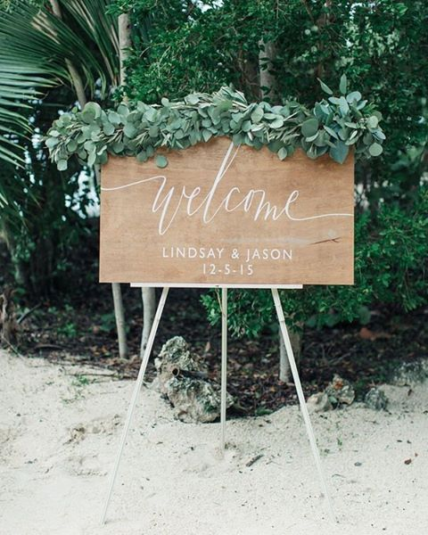 welcome to a super cute sign in today's featured wedding #NowOnGLW // photo @jessicabordnerphoto // florals @designsbydarenda // @starlitdesigns // dress @jennypackham // bridesmaids skirts @joannaaugust