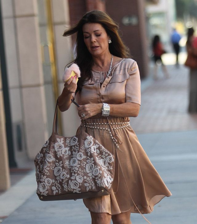 This photo of Lisa and her perfect beige and ivory Valentino Embroidered Flower Tote proves it