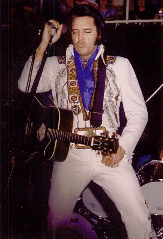 """Elvis Presley wearing his Chief Suit (alternate name: Indian Feather) with original """"Chief Belt"""" and performing in front of 7,437 people in the Asheville Civic Center arena on Tuesday July 22, 1975 