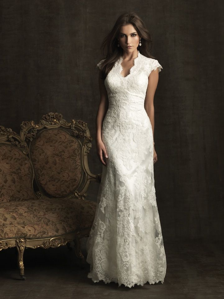 An elegant gown in all-over lace. This gown features a beautiful neckline with contoured straps that continue to a covered back. A chapel length train and covered buttons complete this elegant style.  See store for availability and pricing.