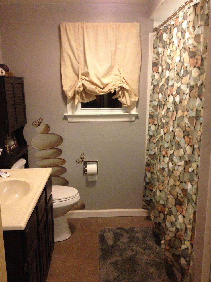 looking into my river rock bathroom i use a shower liner behind the