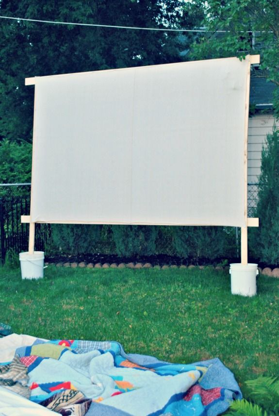 "Make your own movie screen for outdoor movie nights....Simple and inexpensive! I may need to adapt this by adding ""feet"" to help it stand up if needed."