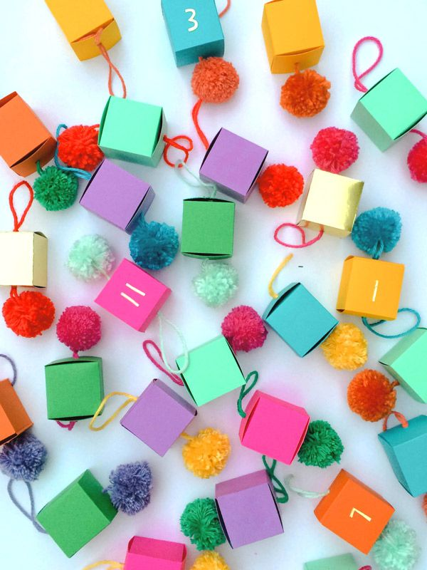 Oh Happy Day ! DIY Paper Ornament Advent Calendar . { super bright advent idea . & . love the addition of the pOm pOms . perfectly bright countdown to christmas } .