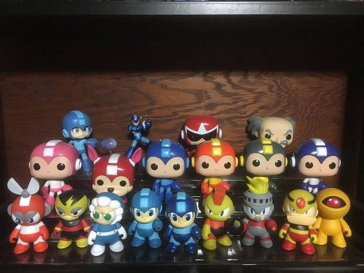 #ToyShelfTuesdays! My #KidRobot and #FunkoPop #MegaMan collection! #ProtoMan #DrWily #CutMan #GutsMan #BombMan #Rockman #Capcom #NES #ClassicVideoGames #PopVinyl #FunkoPopCollector #FunkoPopCollection #AlwaysOpenYourToys  @originalfunko @popvinyl @kidrobot