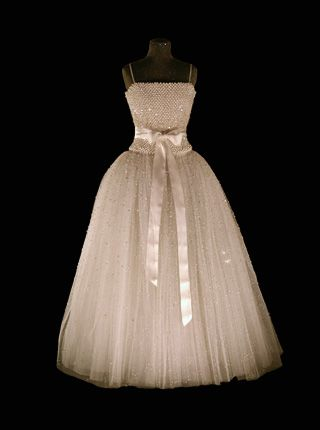 """2001 crystal gown of tulle and pearls for Queen Silvia of Sweden.  """"The Queen's Gowns"""". Nobelprize.org. 28 Aug 2012 http://www.nobelprize.org/nobel_prizes/award_ceremonies/queensgowns/2001.html"""