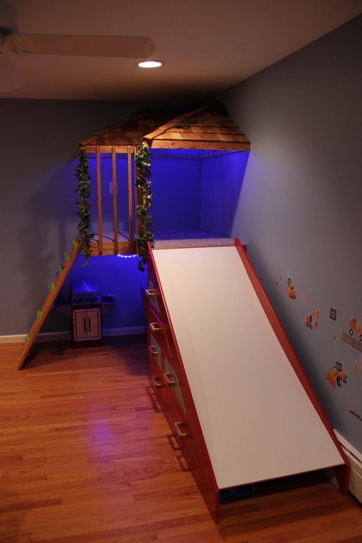 My husband built this for our boys.  We call it an indoor tree house.  Its a fun thing to play on and around.  Our older son loves climbing up and sliding down.  The slide also doubles as a dresser.