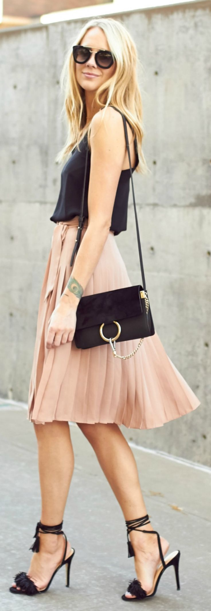 Summer style + salmon pink + pleated skirt + black vest + perfect look + hitting the town + day + night +  Amy Jackson + effortlessly chic + stilettos + sunnies.   Top: Topshop, Skirt: Ann Taylor, Handbag: Chloe, Sunglasses: Prada, Watch: Daniel Wellington