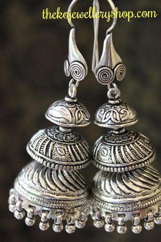 The Anahita Jhumka   The KO Jewellery Shop  A sterling silver jhumka handcrafted to perfection with three different layers each with a unique design the Anahita jhumka is simply magnificient. The pretty silver balls or ghunghroos at the bottom add to its charm.This is a large size jhumka and looks great when paired with a Saree.