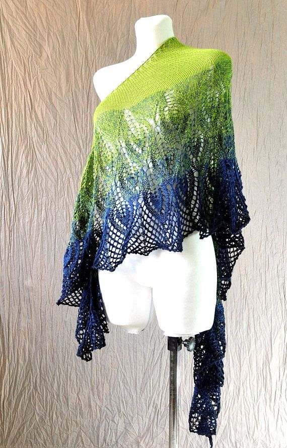Lime and Blue Hand Knit Lace Shawl made of interesting yarn - melange of green and blue, which gives an ombre effect. This amazing shawl is soft and very gentle, it will be great addition to your outfit. Yarn is blend of cotton and microfiber.  Colors: shades of blue and green. Because of different monitors and screen resolutions, color may look different on the screen than in reality.  You can order such shawl in different colors.  Shawl is a crescent-shaped.  Measurements: length 184 cm…