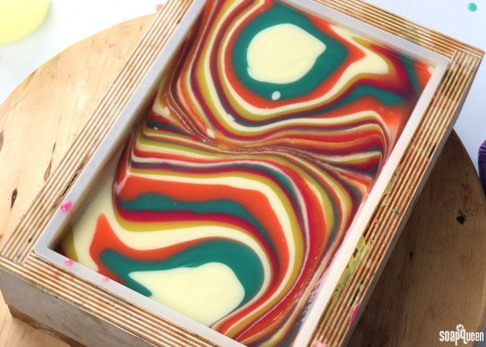 The ability to manipulate the texture of cold process soap allows for a wide variety of techniques. For example, thick textured soap mimics the look of cupcake frosting in the Sparkling Champagne Soap Cupcakes. On the flip side, fluid soap batter is used to create complex swirls in the Clover & Aloe Spin Swirl Soap. Swirling …