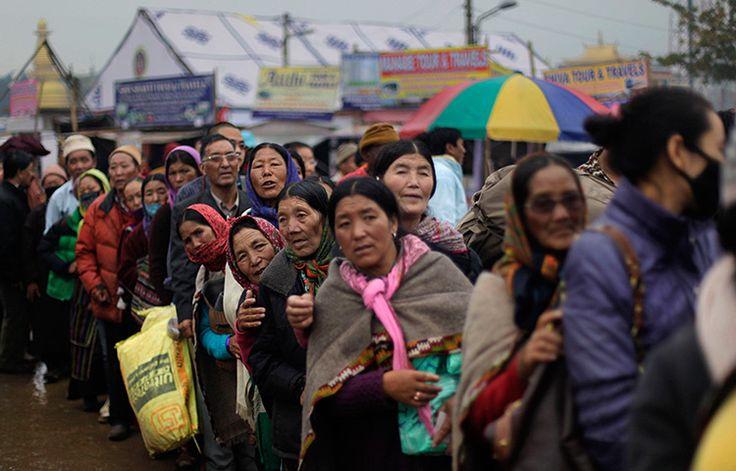 Bodh Gaya, India: Buddhist devotees queue on the first day of the Kalachakra festival
