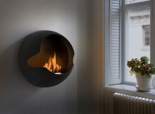 Innovadora Chimenea de Pared de Diseño Circular y Moderno