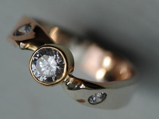 Argyle diamond mobius twist ring.