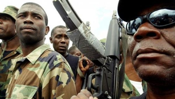 Guy Philippe participates in a march into the city of Gonaives, Haiti, Feb. 19, 2004. | Foto: Reuters