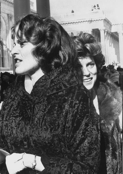 President John F. Kennedy's sisters, Mrs. Peter Lawford(L) and Mrs. Sargent R. Shriver(R) at his Inaugeration.  Location:Washington, DC, US  Date taken:1961  Photographer:Paul Schutzer