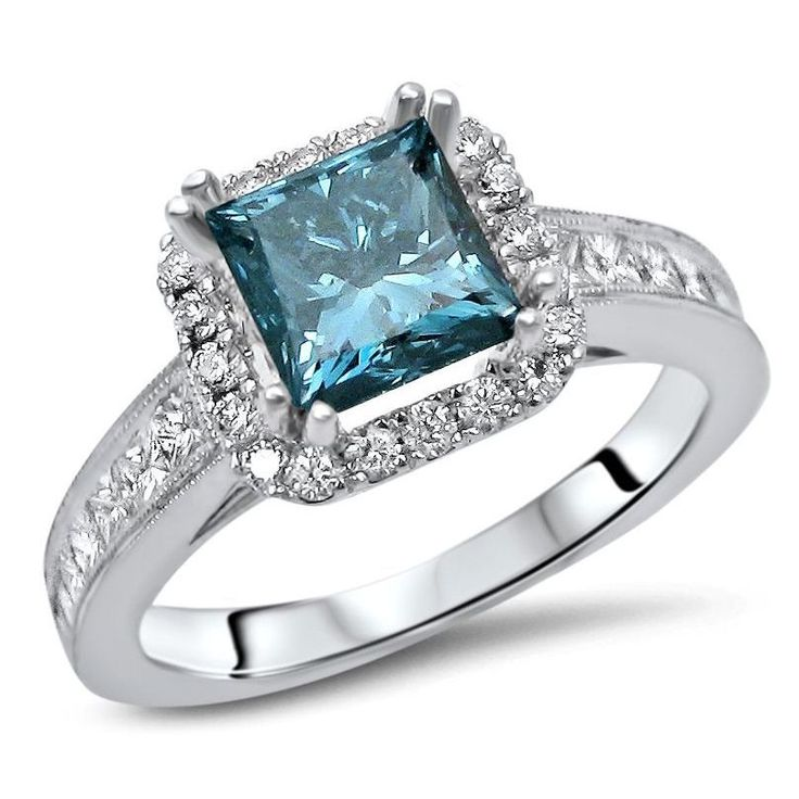 Add elegance to your look with this Noori 18-karat white gold 1 3/4-carat princess cut diamond engagement ring. The center diamond features a lovely blue tint and is surrounded by small diamonds. The band is detailed with side stones.