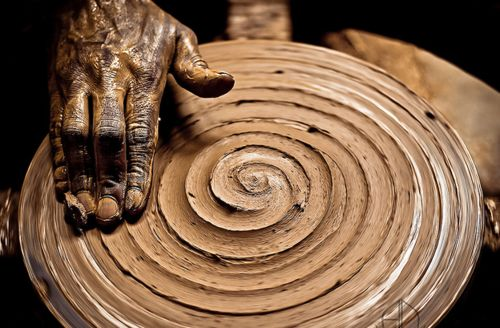 ancient hand forming ancient symbol…