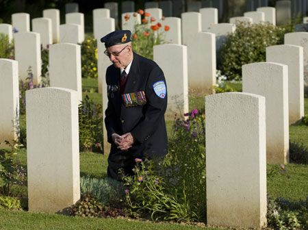 Canadian veteran of the Normandy D-Day invasion Windsor Macdonald, 84, of Moncton, N.B., visits for the first time the grave of his brother 65 years after he was killed, at the Canadian war cemetery in Beny-sur-Mer June 5, 2009.  (Xinhua/Reuters Photo)  Some 156,000 Allied troops landed in France on June 6, 1944, while an estimated 10,000 were left dead, wounded or missing.  At Omaha Beach alone, 3,881 soldiers died.  God Bless Our Canadian Allies! Heroes All!