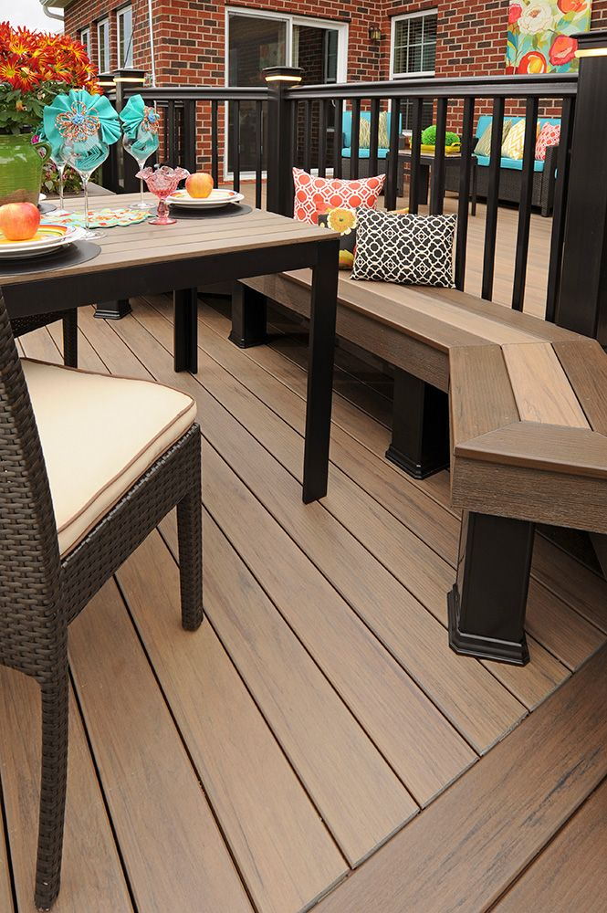TimberTech Deck Legacy Collection in Pecan with Eclectic style decor. Consider a bench like this one to add seating to your deck.