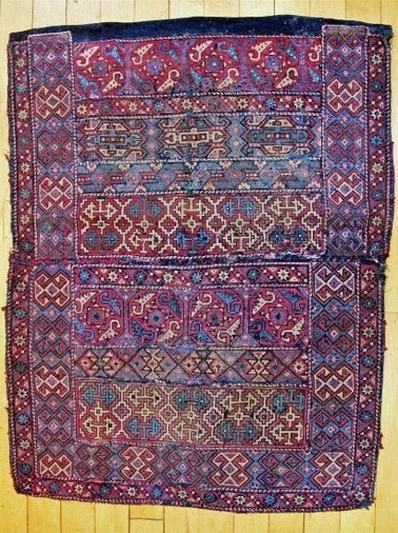 Armenian apron, for women. From 'western Armenia'/Anatolia, 19th century. Cross-stitch embroidery in wool, on a dark blue wool ground. (Private collection, USA).