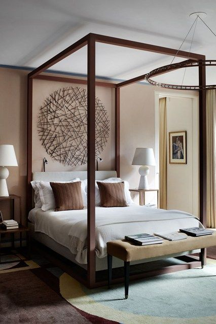 Discover bedroom design ideas on HOUSE - design, food and travel by House & Garden. A gigantic circular sculpture by Lizzie Farey, hangs behind a modern four-poster bed.