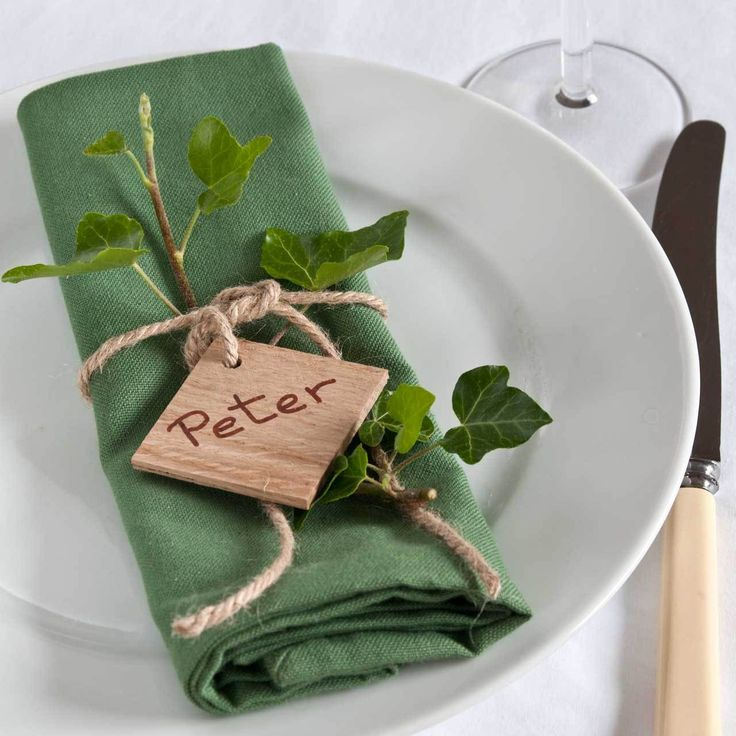 Square Wood Tag with a single hole for threading twine or narrow ribbon to attach around a napkin at your guest's place setting. Write or stamp the name and tuck a sprig of foliage behind the tie for a rustic, country wedding table setting. £0.45 (http://www.englishwoodlabels.co.uk/square-wood-tags/)