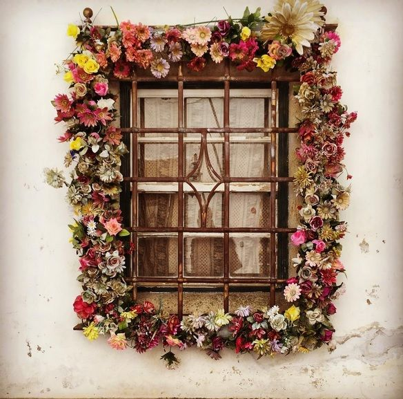 Wishing you many random moments of beauty. This little moment is an ancient window in the 15th century village of Obidos Portugal surrounded by vintage silk flowers. #momentofbeauty #itsallinthedetails #windows