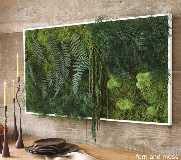 Sculpted by nature and arranged by artisans, these real plants create a uniquely verdant showpiece. The ferns and thick blankets of moss rise up in three dimensions from their surrounding frame as if in a tropical jungle setting. Audaciously original and certain to be a focal point, this eco-preserved art requires no watering.